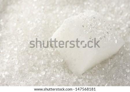 Granulated sugar and sugar cube as background. #147568181
