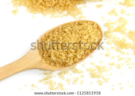 granulated sugar from sugar cane, granulated sugar brown in a white cup, granulated sugar yellow on spoon wooden over white background