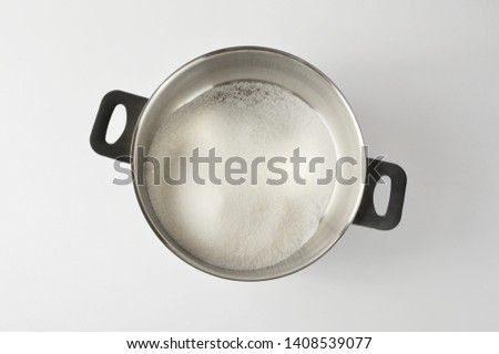 Granulated sugar in a saucepan, cooking dessert
