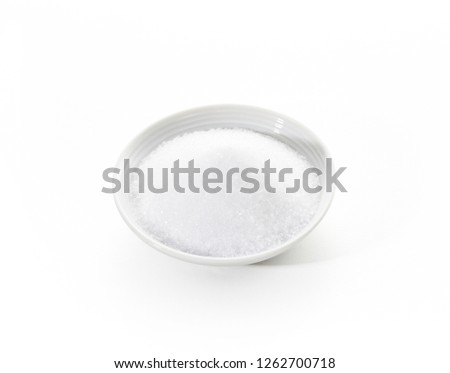 Granulated sugar on white background