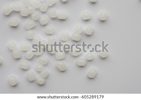 Granules of polyethylene of high pressure on a white background #605289179