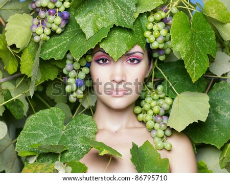 Grape goddess. Beautiful young lady, wrapped in grape
