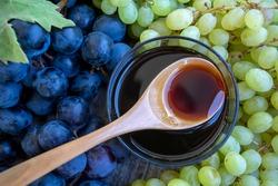 Grape molasses and fresh organic grapes