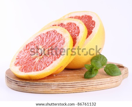 Grapefruit, a sliced half on a white background