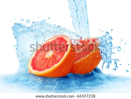 grapefruit in a spray of water isolated on a white background