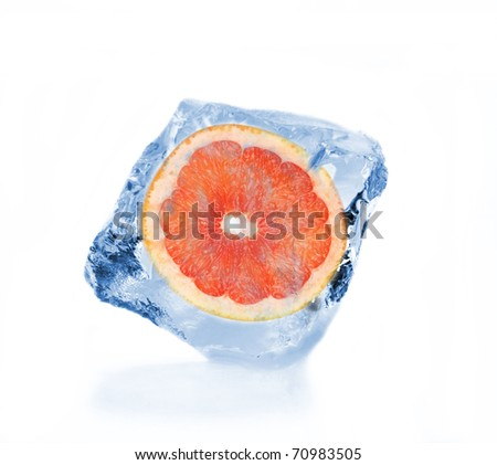 Grapefruit slice frozen in ice cube, isolated on white background