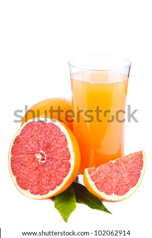 grapefruits and glass of grapefruit juice isolated on a white background
