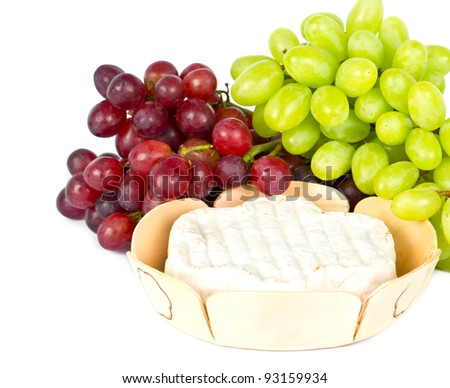 grapes and cheese on white background