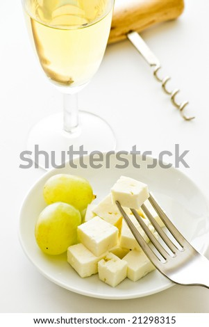 grapes cheese and wine on white