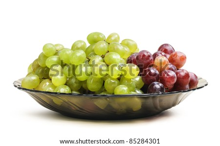Grapes in a glass dish on white background