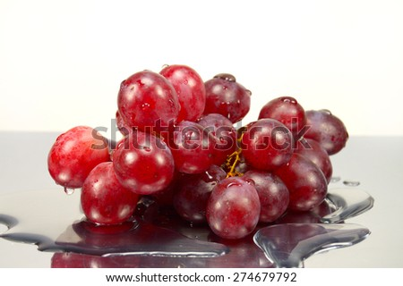 grapes in drops of water on the mirror surface