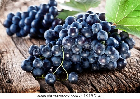 Grapes on a old wooden table.