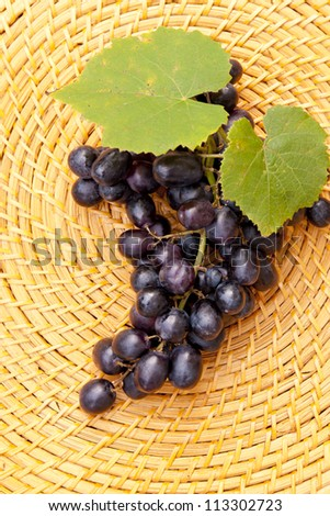 Grapes on straw plate