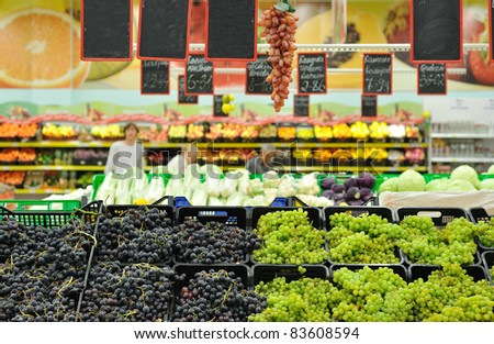 grapes on the counter in the market