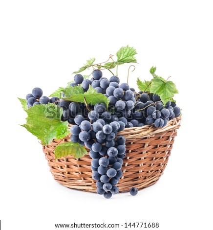 Grapes with leaves in wicker basket, Isolated on white background