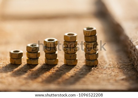 Graph of a Screw nuts. Growth concept. #1096522208