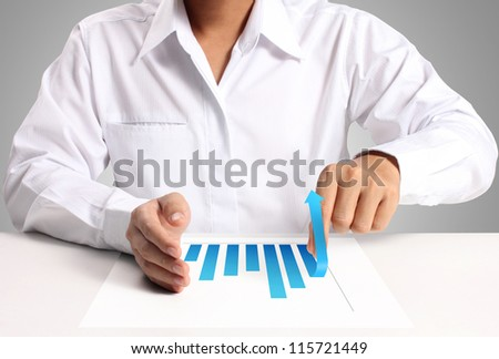 graph of paper in hand businessme