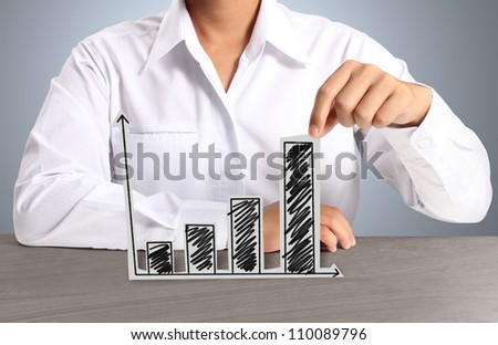 graph  of paper in hand businessmen