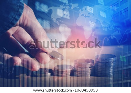 Graph on rows of coins for finance and Saving money on digital stock market financial exchange and Trading graph Double exposure city on the background