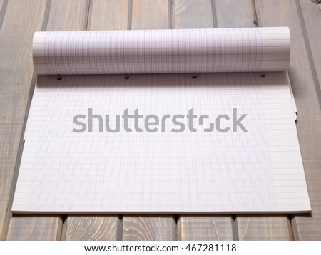 Graph paper. School supplies on old wooden background. Magazine. Top view. Copy space. #467281118