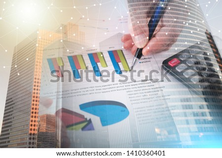 Graphic analyzed by a businessman (random latin dummy text used); multiple exposure