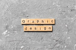 graphic design word written on wood block. graphic design text on cement table for your desing, concept.