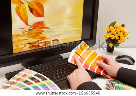 Graphic designer at work. Color samples. Brown, yellow images