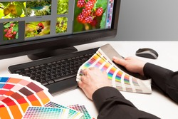 Graphic designer at work. Color samples. Photo picture fruit and nature