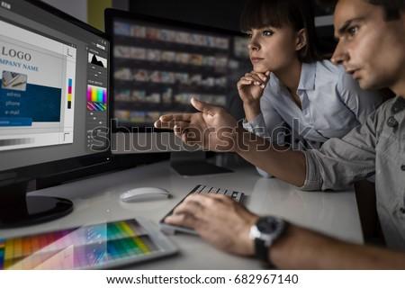 Graphic designer at work. Color swatch samples. #682967140