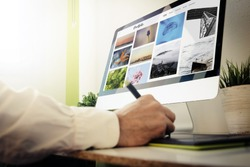 Graphic designer checking online portfolio website. All screen graphics are made up.