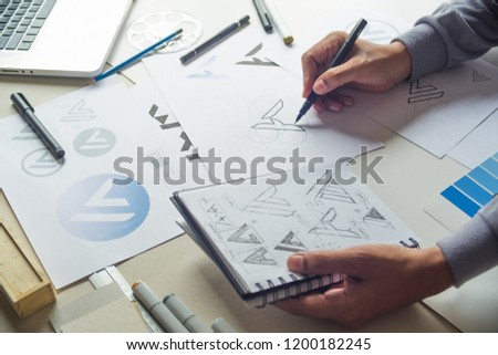 Graphic designer drawing Logo  #1200182245
