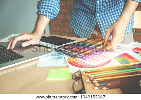 Graphic designer drawing on graphics tablet at workplace #1049155067