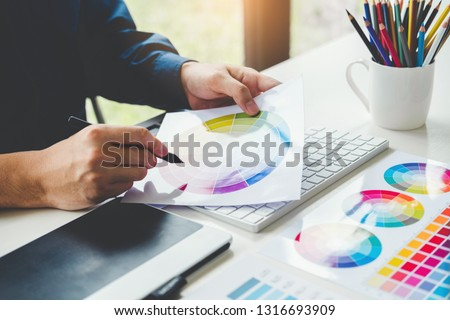 Graphic designer drawing on graphics tablet at workplace #1316693909