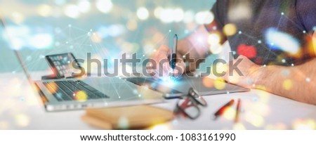 Graphic designer on blurred background using futuristic connection interface 3D rendering #1083161990