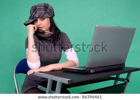 Graphic designer with brush and laptop.
