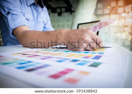 Graphic designer working at office. #591438842