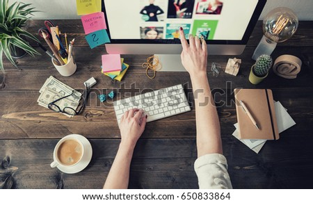 Graphic Designer working in a home office #650833864