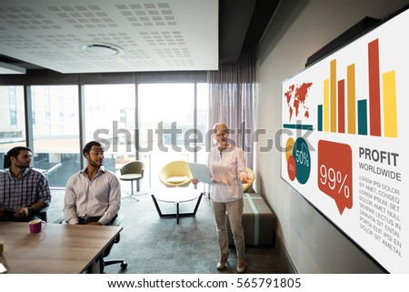 Graphic image of business presentation against businesswoman giving presentation #565791805
