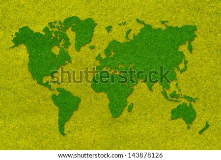 Graphic of world map shaped green grass on green grass background
