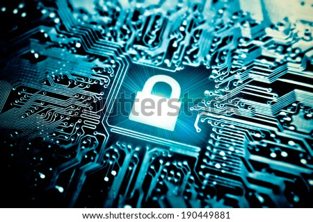 graphic symbol of a lock on a computer circuit board - computer security system stock photo