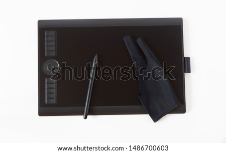 Graphic tablet, pen and black glove for illustrators and designers on the white background. Top view #1486700603