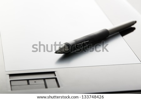 Graphic tablet with pen close-up