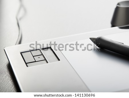 Graphic tablet with pen on table #141130696