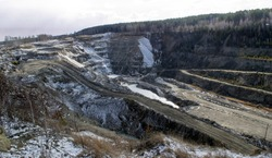 Graphite quarry. Open pit mining of graphite