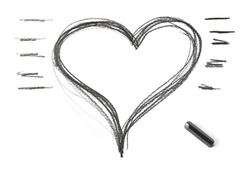 Graphite stick and grunge heart shape isolated on white background