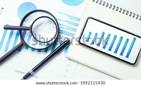 Graphs and charts elements on phone screen  and statistical performance of the company. #1092115430
