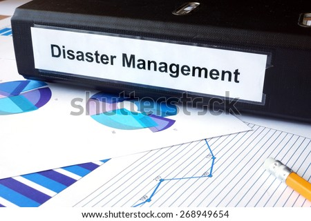 Graphs and file folder with label  Disaster Management. Business concept. #268949654