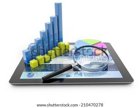 graphs and magnifier over a portable computer on white background