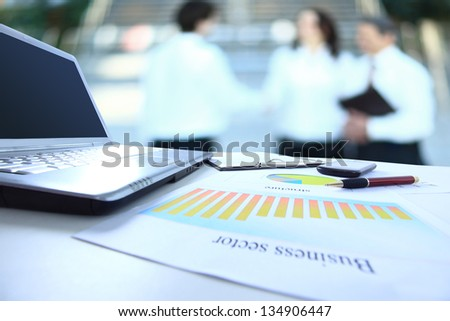 Graphs, charts, business table. The workplace of business people