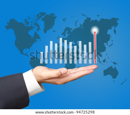 Graphs on the hands of businessmen - stock photo